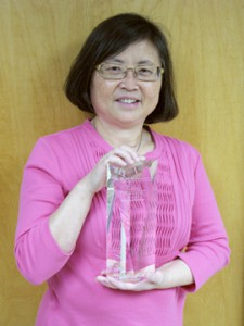 Dr. Mei Baker with her APHL award.